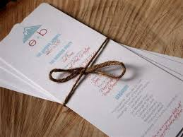 cheap ceremony programs programs printed on white cardstock and cut in half paper