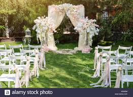 how to decorate a wedding arch wedding arch decorated with cloth and flowers outdoors beautiful