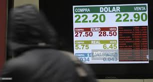 currency exchange values are seen in the buy sell board of an