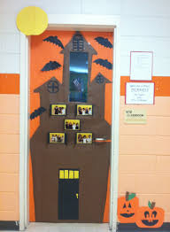 thanksgiving classroom door decorations make a haunted house with students pics in windows in the
