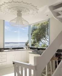 stunning coastal kitchen design with large elaborate ceiling