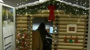 woman transform cubicle holiday themed log cabin win company