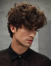 men u0027s hairstyle with latin style curls and a low sitting fringe