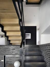 architecture black stairs split level house rustic brick wall