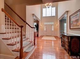 traditional hallway with hardwood floors u0026 wainscoting in raleigh