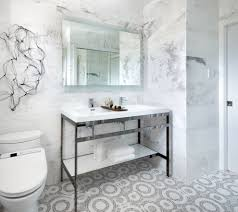 love the circular tile design on the floor bathroom space for a