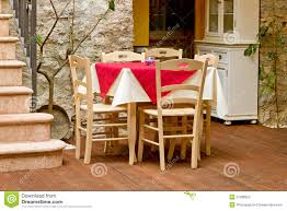 table and chairs in italy country style stock photo image