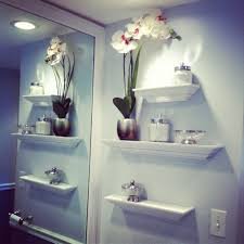 bathroom best ideas for decorating walls bathroom modern rack wall decoration white flowers vase some jars glass bowl