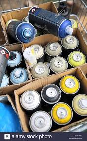 Spray Cans Paint - a graffiti artist u0027s spray paint cans lie in a shopping cart in