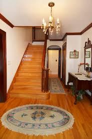spacious entryway with original hardwood floors and unpainted gum