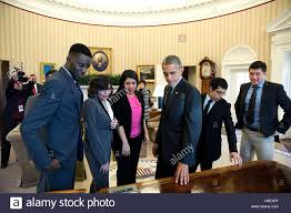 oval office tour u s president barack obama shows the resolute desk to a group of
