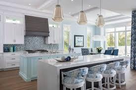 white kitchen cabinets with aqua backsplash naples based interior design firm furnishes waterfront