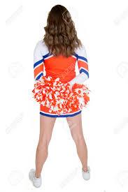 Cheerleader Flags Back Of Teen Cheerleader Standing Orange Pom Poms Stock Photo