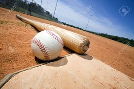 baseball and bat on home plate of a ballpark stock photo picture