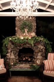 outdoor rock fireplace dressed for christmas french country cottage