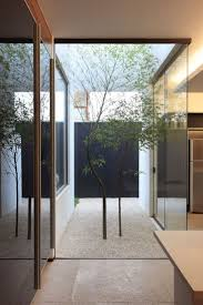 view in gallery small courtyard dividing a kitchen from other