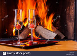 food and drinks at fireplace in winter stock photo royalty free