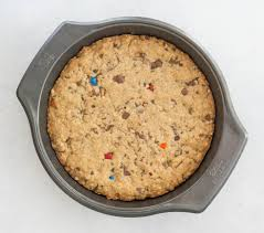 candy bar monster cookie cookie cake the itsy bitsy kitchen
