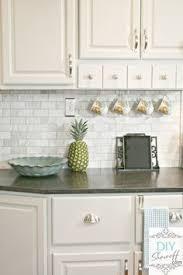 white shaker kitchen cabinets backsplash marble subway tile backsplash with jet mist honed granit