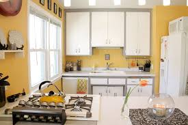Kitchen Yellow Walls - white cabinets island sink and refrigerator pastel yellow