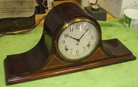 decorating mantel clocks with wooden floor and lighting lamp for
