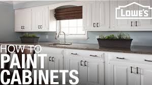 is it better to paint or spray kitchen cabinets how to paint cabinets