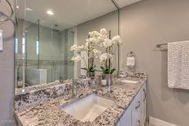 contemporary master bathroom with penny tile floors u0026 flat panel