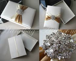 wedding invitations in a box nickel color rhinestone brooch embellished white wedding box