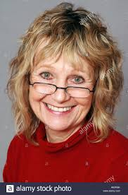 hairstyles for sixty year old women smiling sixty year old woman wearing glasses stock photo royalty