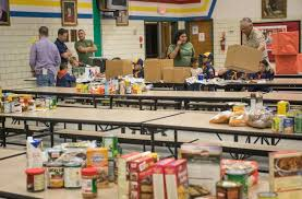 cub scouts give thanksgiving baskets during