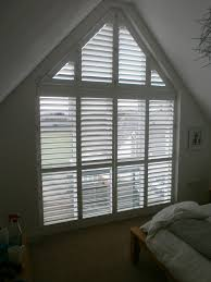 a tall gable end window with phoenix wood shutters project
