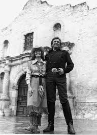johnny cash and june carter cash in front of the alamo 1982