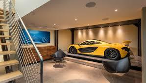 a stunning subterranean garage anchors the modern glass walled