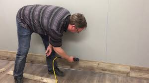 Installing Laminate Flooring Youtube Laminate Flooring Wall Installation Youtube