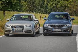 bmw 328i xdrive vs audi a4 quattro bmw 3 series gt vs audi a5 sportback comparison test autoevolution