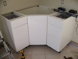 cherry wood windham door corner kitchen sink base cabinet