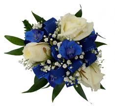wrist corsage prices 3 white roses blue delphinium wrist corsage in akron pa