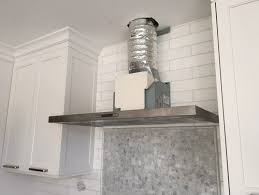 Kitchen By Guide To Fixing by Kitchen Ventilation Design Guide Hoods Installation