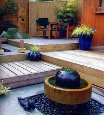 multi level wooden deck with water features backyard deck