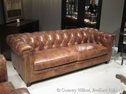 Tufted Brown Leather Sofa Brown Leather 2 Cushion Sofa With Tufted Back And Nail Heads