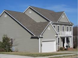 Light Gray Siding and Dark Gray Roof  Roof and Siding Replacement