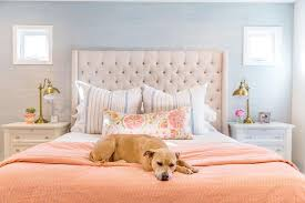 cream and gray bedroom with orange accents transitional bedroom
