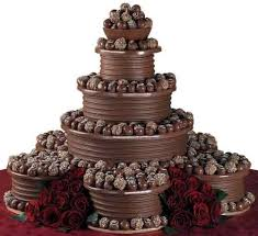 chocolate wedding cakes dipped truffles crown the top of this magnificent wedding