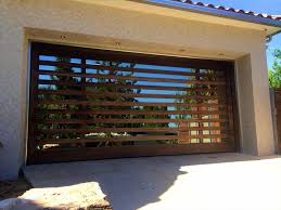 accents metal modern garage doors with windows that look like wood