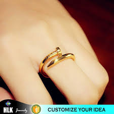 gold rings stones images Gold fashion nail ring with spring design trending gold rings jpg