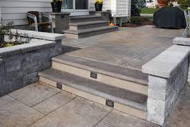 stairs and landing stamped concrete patio deck and screen