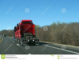 volvo highway tractor semi tractor hauling three semi trucks red on highway editorial