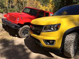 old yellow jeep chevy colorado z71 trail boss tackles colorado rockies as jeep