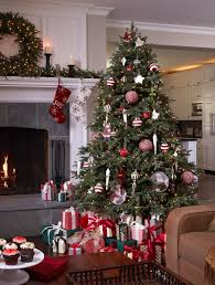 a fraser fir christmas tree beautifully decorated with a red and