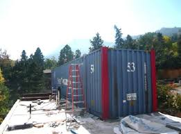boulder couple building house made of shipping containers